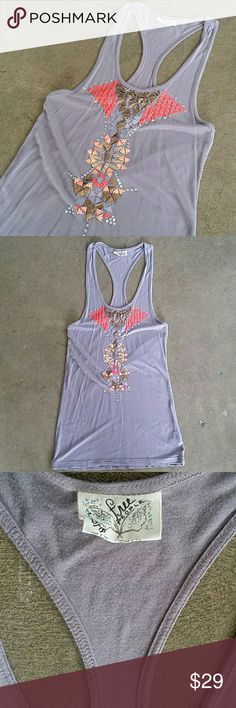 FREE PEOPLE Racerback tank Thus is such a beautiful top! It's a light purplish grey ish color with brightly colored sequin and jewel accents to form a beautiful tribal pattern.  Racerback tunic style  Sz Xs and TTS Preowned and very gently worn Beautiful condition  Bundle to save Free People Tops Tunics