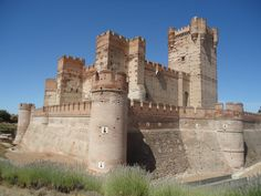 CASTLES OF SPAIN - Castillo de la Mota, Valladolid. The Castle of the La Mota is a medieval fortress, located in the town of Medina del Campo, Initial fortification of the village, repopulated after Moorish depredations, led to the creation of a fortress on the site, starting in 1080. In 1354, Henry of Trastamara is known to have taken the fortress by force. In 1390 King John I of Castile granted the town to his son, the infante Ferdinand of Antequera, future king of Aragon.