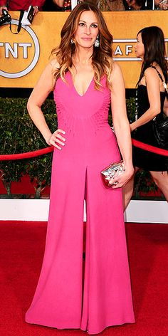 Last Night's Look: Love It or Leave It? | JULIA ROBERTS | Julia has been on her fair share of red carpets, so it's understandable if she's grown sick of wearing boring old gowns and decided to shake things up with a plunging, very wide-leg pink onesie.