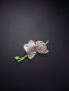 Orchid by Luz Camino : email, diamants, rubis, argent et or One of an edition of 6 different colors