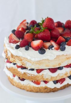 Angel Food Cake with Coconut Whipped Cream and Berries   Patriotic 4th of July recipes from @cydconverse plus more 4th of July party ideas, entertaining ideas and more!