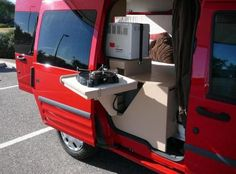 The stove can swing out so you can cook inside or outside the Transit.