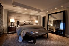 Accessories & furniture,Stunning Manly Bedrooms Decorations With Wooden Headboard And Bedside Bench Featuring Bedside Table Lamp And Big Mirror Combine With Recessed Ceiling Light And Rug Area,Extraordinary Masculine Bedroom Decorations