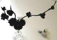 Black Crepe Paper Flowers attached to black crepe paper covered twigs. How to at carolynshomework.blogspot.com she has a link to make the flowers