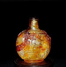 An Important Antique Qing Golden Amber Snuff Bottle