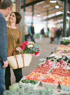 A farmer's market engagement Photography: The McCartneys Photography - www.meetthemccartneys.com  Read More: http://www.stylemepretty.com/2014/06/18/farmers-market-engagement-in-minnesota/