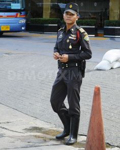 In Thailand, rubber boots are a regular part of a policeman's uniform--rain or shine.