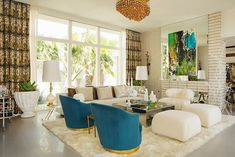 Vibrant contemporary living room with mirrored coffee table [Design: Woodson & Rummerfield's House of Design]