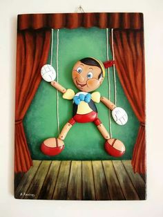 Pinocchio 3D . Painted pebbles glued on wood painted with acrylic paints . 2014 By Leftetis Kanetis
