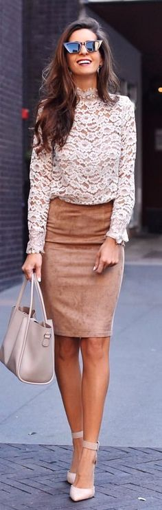 white floral long-sleeved top and brown skirt. Pic by @myviewinheels