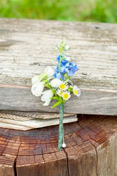 Wildflower boutonniere for a Berkshires wedding at Camp Wa Wa Segowea. Photos by Mikkel Paige Photography, destination wedding photographer. #wildflowerboutonniere #wildflower #boutonniere #rustic #rusticwedding