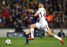 Lionel Messi of Barcelona is challenged by Kostas Manolas of AS Roma during the UEFA Champions League Quarter Final Leg One match between FC Barcelona and AS Roma at Camp Nou on April 4, 2018 in Barcelona, Spain.