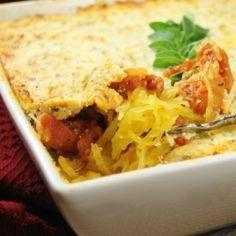 Baked Spaghetti Squash Gratin - spaghetti squash with spicy tomato sauce, topped with ricotta-Parmesan gratin. Yum.