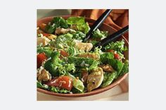 Frozen veggies, precooked chicken strips and greens are tossed with a zesty blend of Italian dressing and soy sauce in this easy entrée salad.