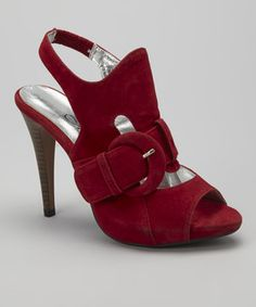 This velvety pair comes ready for the red carpet with a sky-high heel, buckle detail and sultry slingback silhouette.
