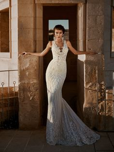 Stunning slip fit and flare style wedding dress. Detailed designed lace covering entire dress with beading and clear sequin to add sparkle. V-Neckline with sheer illusion bodice and button closure at back. Friend Wedding, Fit And Flare, Bridesmaid Dresses, Bridesmaids, Wedding Gowns, Sequins, Bridal, Formal Dresses, Bodice