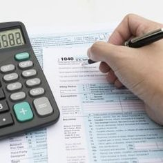 Close-up of woman filling out tax paperwork.