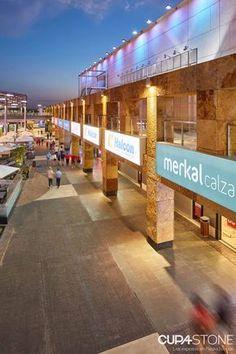 5278c4d89998 Cuarcita Carioca Bronce  luz hecha piedra en la fachada ventilada del  Centro Comercial Nassica.