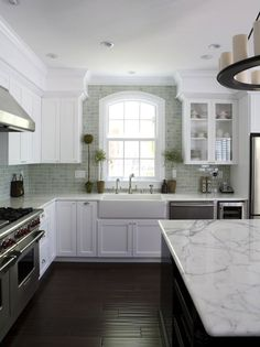 How perfect is this kitchen? Love the simplicity with the backsplash and white cabinets. Those countertops and floors are gorgeous!