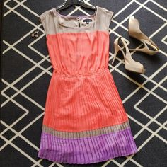 Pretty in Pastel Dress Paint the town pastel in this ultra feminine dress by American Eagle Outfitters. This never worn piece has a pleated bottom and peek-a-boo back. Shoes and accessories not included. Interested? Let's chat! DISCLAIMER: this dress has never been worn but no longer has the retail tag. American Eagle Outfitters Dresses
