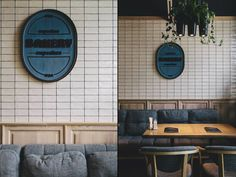 The restaurant is divided in 3 zones, each one decorated with hanging on the walls panels containing names of bakery from different countries, green plants and produced by local manufacturer hanging pots with incorporated lighting, designed by Roderick Vos.