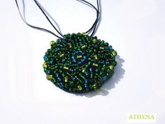 Crochet pendant - AMAZONIA   by Athena005