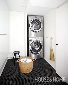 Cloud White keeps this basement laundry room looking fresh and conceals floor-to-ceiling cabinets that store household essentials. | Photographer: Angus Fergusson | Designer: Suzanne Dimma