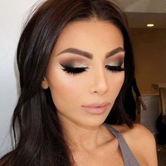 Show stopping full lashes paired with beautiful bronze glitter and a neutral lip color.