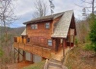 Smoky View is conveniently located between Gatlinburg and Pigeon Forge. It's set back from the road, resting along a wooded ridge-top and offers a wonderful view of the Smoky Mountains in the distance.This Smoky Mountain log cabin is two levels with high beamed ceilings and has clear story windows to take in the natural light and beauty.
