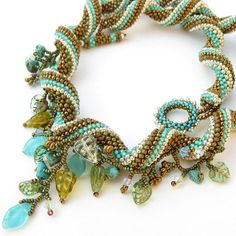 Beaded spiral necklace in Turquoise, White, Silver and Summer Green. $165.00, via Etsy.