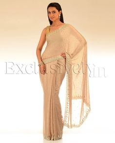 Beige Self Printed Sari With Gold & Silver Beaded Border - Exclusively In