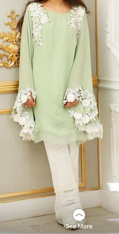 Pistachio green and white! Or you could call it lime gelato green and white, depending on which flavor appeals to you more!Warna ijonya okFor price and details contact on WhatsApp Stylish Dresses For Girls, Stylish Dress Designs, Simple Dresses, Casual Dresses, Fashion Dresses, Pakistani Dresses Casual, Pakistani Dress Design, Kurta Designs Women, Blouse Designs