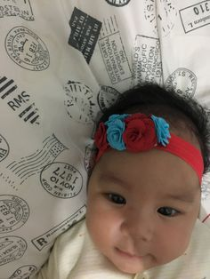 Masayu with red blue flower headband