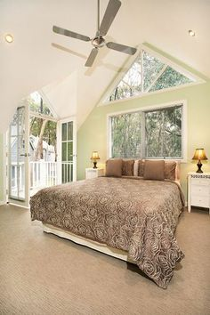 Stunning room, big windows and french doors with a peaked roof.