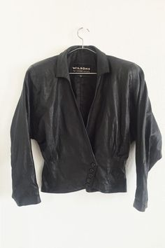 Leather heaven!! This vintage leather 1980's jacket from Handpicked LA is a must have! Super unique with it's corset inspired bodice!