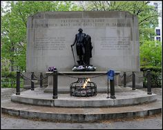 """The Tomb of the Unknown Revolutionary War Soldier (sometimes written as Tomb of the Unknown Soldier of American Revolution) is a war memorial located in Washington Square in Philadelphia, Pennsylvania. It honors the thousands of soldiers who died during the American Revolutionary War, many of whom were buried in mass graves in that park.    The memorial was built in 1954 and features an eternal flame and a statue of George Washington gazing toward Independence Hall"