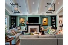 family room - layout with max seating and desk/sofa table. I love the color, the bird, the pillows....looks GOOD!