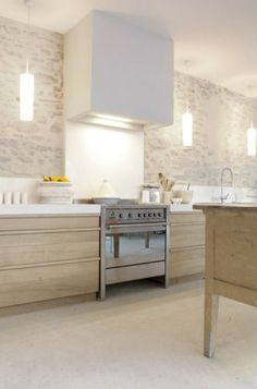 Combination of wood and white; kitchen| Interior Designer: Marie-Laure Helmkampf