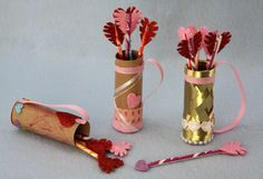 Cupid Quiver | Sophie's World -- create a toilet paper tube quiver with Pixie Stick arrows!