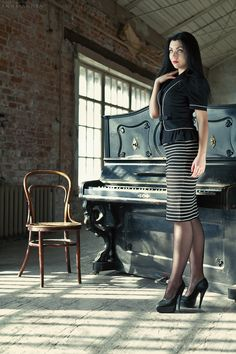 Black pantyhose teasing by piano — img 2