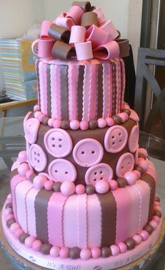 Pink and brown buttons/stripes cake