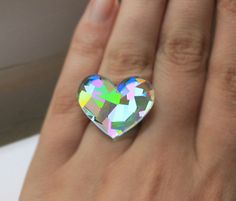 Holographic+laser+cut+acrylic+ring+on+silver+plated+adjustable+ring+base.