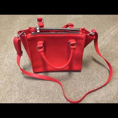 Express red purse Beautiful sleek red purse. Wear day or night. Express brand. NWT Express Bags Mini Bags