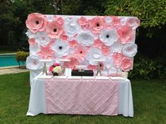 Pink and white paper flower wall panel for dessert table
