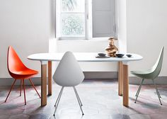 Arne Jacobsen's iconic Drop chair to be reintroduced by Fritz Hansen.  Molded version comes with color matching legs.