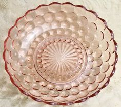 Vintage Anchor Hocking Bubble Pink Round 8 1/2 Inch Bowl is a shallow vegetable bowl made by Anchor Hocking and is identified as Bubble Pink. This pattern was produced beginning in the 1940s and was d