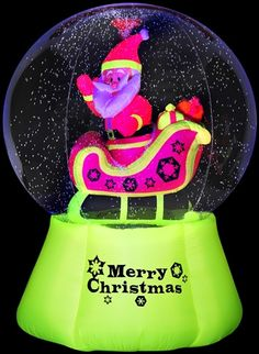 Santa in Neon Globe Christmas Inflatable.  Santa rides his magical sleigh inside this incredible outdoor snow globe.  Snow swilrls continuously inside the globe.  This globe lights up in amazing neon colors