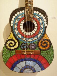 Been wanting to mosaic a couple of old junk violins I have for a few years now but haven't gotten around to it. This should inspire me... Maxwell Mosaics - Guitars