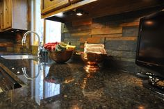 """Uba tuba granite counter with slate tile backsplash cut down into 1"""", 2"""" and 3"""" x 12"""" pieces and stacked without grout joints. Description from tileideasforhome.com. I searched for this on bing.com/images"""
