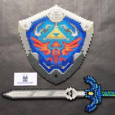 LoZ Hylian shield and Master sword perler beads by  sdkdesigns